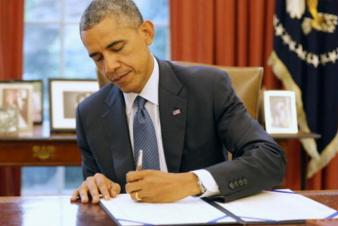 photo of President Obama signing the RESTORE Act